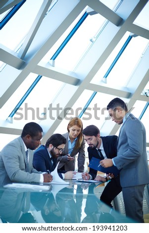 Group of business people discussing data or planning work  - stock photo