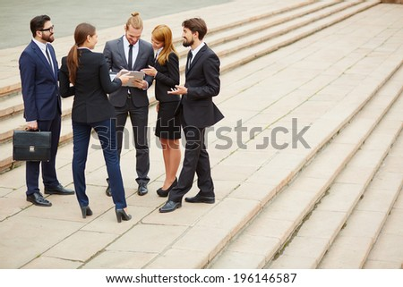 Group of business people discussing ideas at meeting - stock photo