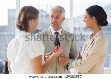 Group of business people discussing together in their office - stock photo