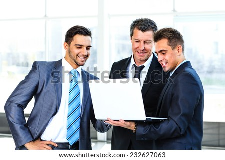 group of business people doing presetation with laptop during meeting - stock photo