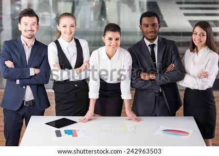 Group of business people during work in office are looking at the camera. - stock photo