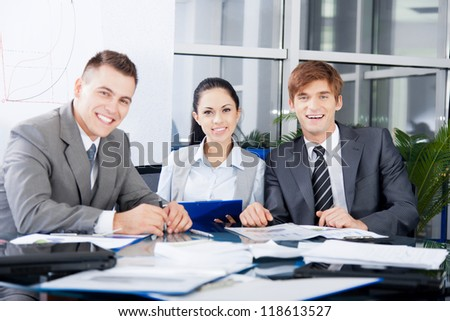 Group of business people happy smile work together, businesspeople working at meeting with colleague team sitting at desk in office - stock photo