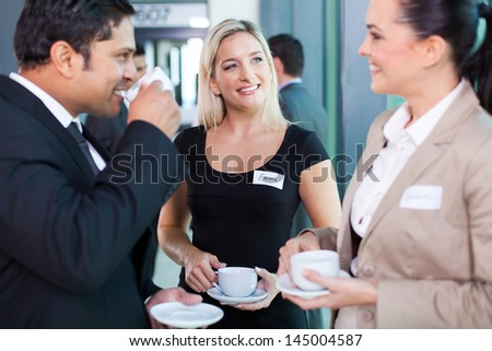group of business people having coffee break during seminar - stock photo