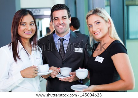 group of business people having coffee during business conference break - stock photo