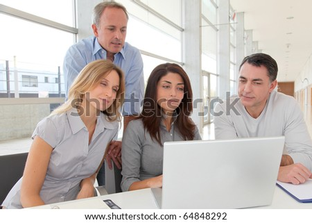 Group of business people in a work meeting - stock photo