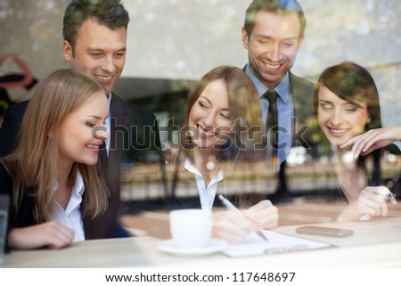 Group of business people in coffee shop. - stock photo