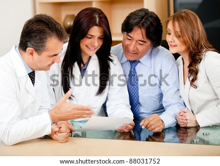 Group of business people in meeting with doctors offering medical insurance - stock photo