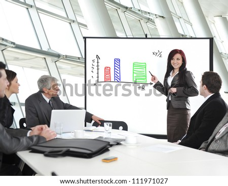 Group of business people in office at presentation with flip chart - stock photo