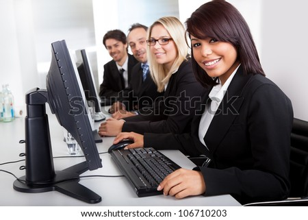Group of business people in the office working on computers - stock photo