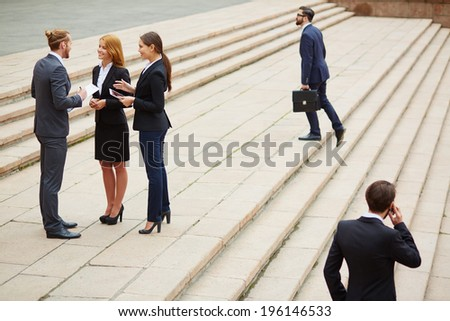 Group of business people interacting outside - stock photo