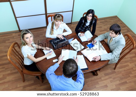 Group of business people interacting together at the office. - stock photo