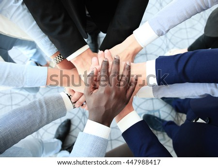Group of business people joining hands - stock photo
