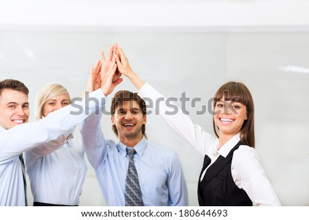 Group of business people joining hands together, collaboration team at office meeting, businesspeople smile leader hold pile of hands, concept of colleagues working together cooperation - stock photo