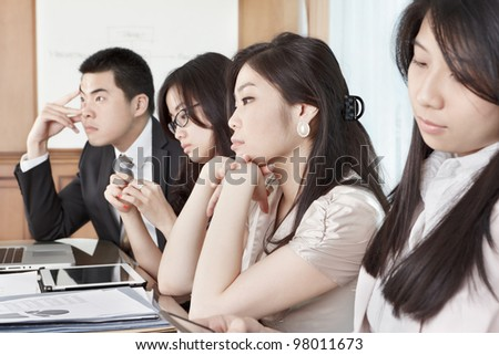 Group of business people look bored during meeting - stock photo