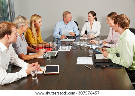 Group of business people negotiating in a conference room - stock photo