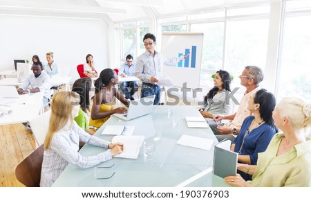 Group of Business People Planning and Listening to the Dicussion of their Colleague - stock photo