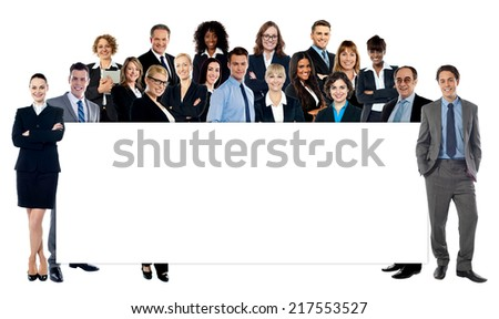 Group of business people presenting empty banner - stock photo