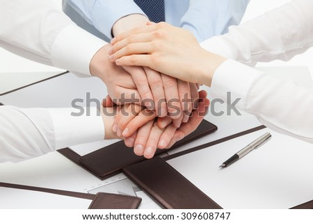 Group of business people's hands, white background - stock photo