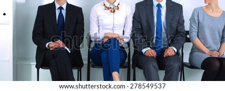 Group of business people sitting on chair in office . - stock photo