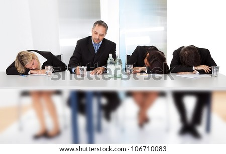 Group of business people sleeping at the meeting - stock photo