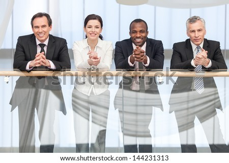 Group of business people smiling on camera. Fron View - stock photo
