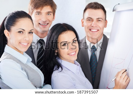 Group of business people team looking draw chart on white board, businesspeople presentation woman explaining graph diagram on whiteboard to colleagues in office - stock photo