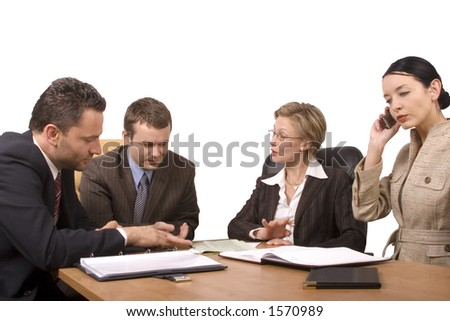 Group of business people, two women two men negotiate at the desk - stock photo