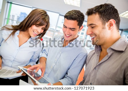 Group of business people using a tablet computer - stock photo