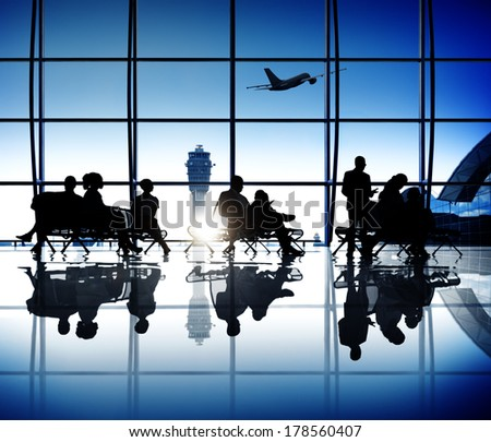 Group of Business People Waiting at Airport - stock photo