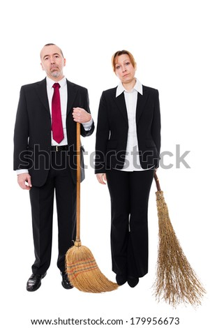 group of business people with brooms were dismissed - stock photo