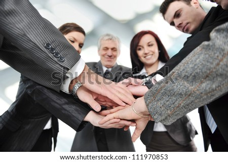 Group of business people with hands together - stock photo