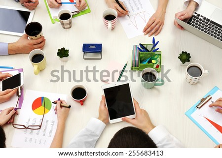 Group of business people working at desk top view - stock photo