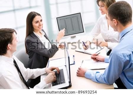 Group of business people working at office - stock photo