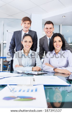 Group of business people working at office desk work together, businesspeople colleague team sitting at desk in office - stock photo