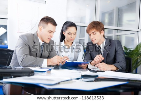 Group of business people working on plan in a meeting at office desk work together, businesspeople colleague team sitting at desk in office discussing report document - stock photo