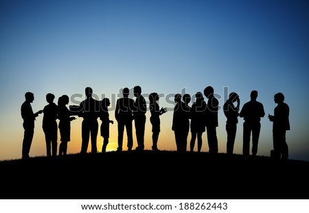 Group of business people working outdoors. - stock photo