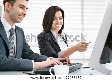 Group of business people working with computer - stock photo