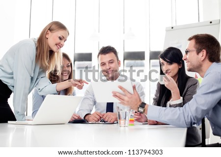 Group of business people working with digital tablet in office - stock photo
