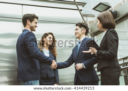 Group of business team shaking hand - stock photo