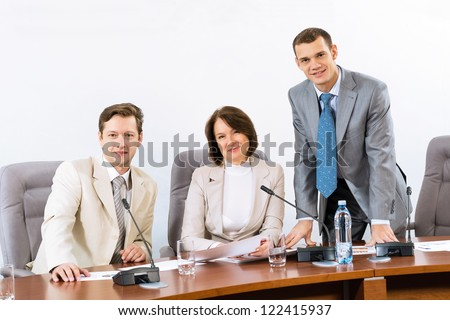 group of businessmen at the table for conferences, team work in business - stock photo
