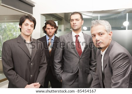 Group of businessmen in office, group of young executives - stock photo