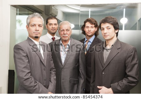 Group of businessmen in office, senior businessman with his colleagues - stock photo