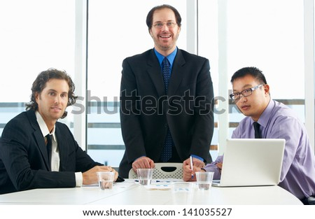 Group Of Businessmen Meeting In Office - stock photo