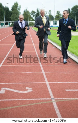 Group of businessmen running on a track. How's gonna win? - stock photo