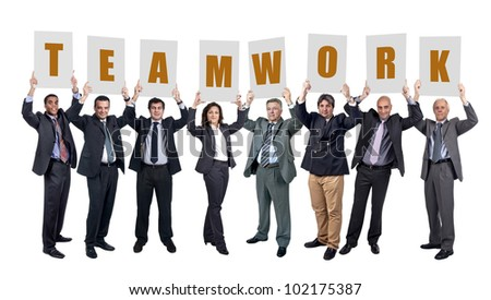 """Group of businessmen with cards with the word """"Teamwork"""" isolated in white - stock photo"""