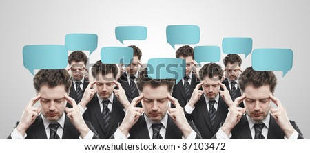 Group of businessmen with social chat sign and speech bubbles. Thinking men representing a social network. Conceptual image of a open minded men.On a gray background - stock photo