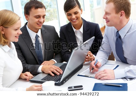 Group of businesspeople gathered to have a discussion about business plan - stock photo
