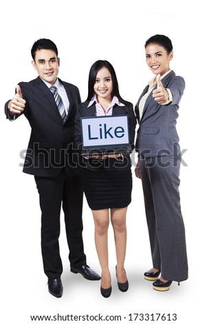 Group of businesspeople showing the word 'like' on laptop. Isolated on white background. - stock photo