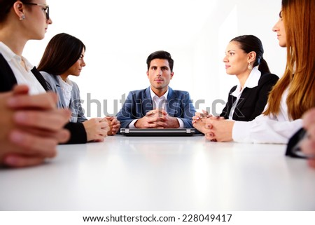 Group of businesspeople sitting on the meeting at office - stock photo
