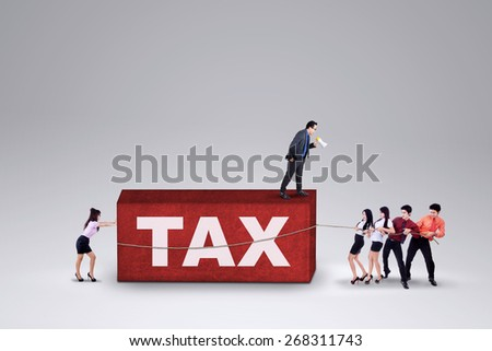 Group of businesspeople try to pull a tax burden, isolated over white background - stock photo